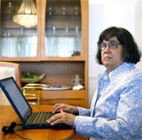Donna Jodhan sitting at her computer