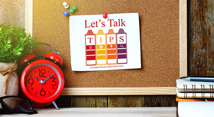 A bulletin board with a page tacked to it that says, 'Let's Talk Tips' in bright colours.